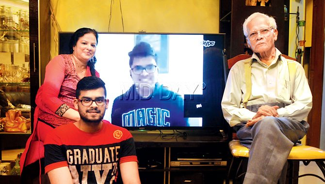 Rahul Sadwelkar's family in Kandivli, with Rahul seen on a shade around Skype. Pic/Nimesh Dave