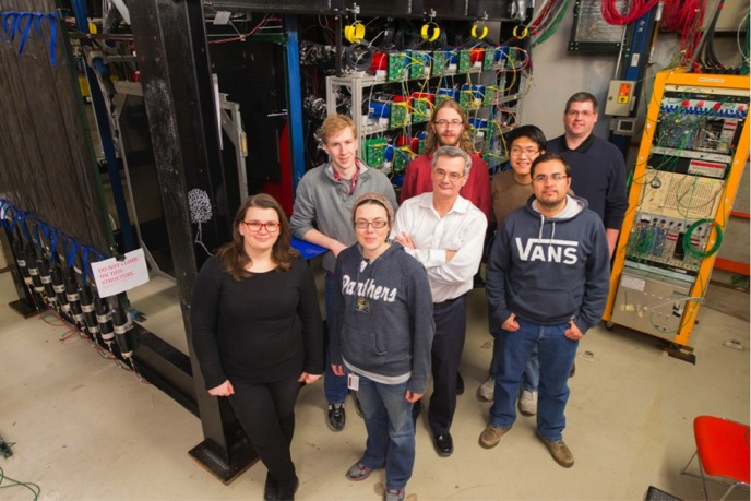 Pictured here is partial of a exam lamp crew. From left: Anne Norrick (College of William and Mary), Rob Fine (University of Rochester), Carrie McGivern (University of Pittsburgh), Leo Bellantoni, (Fermilab, front), Dan Ruterbories (University of Rochester, in red), Aaron Bercellie (University of Rochester), Manuel Alejandro Ramirez (University of Guanajuato), Geoff Savage (Fermilab).